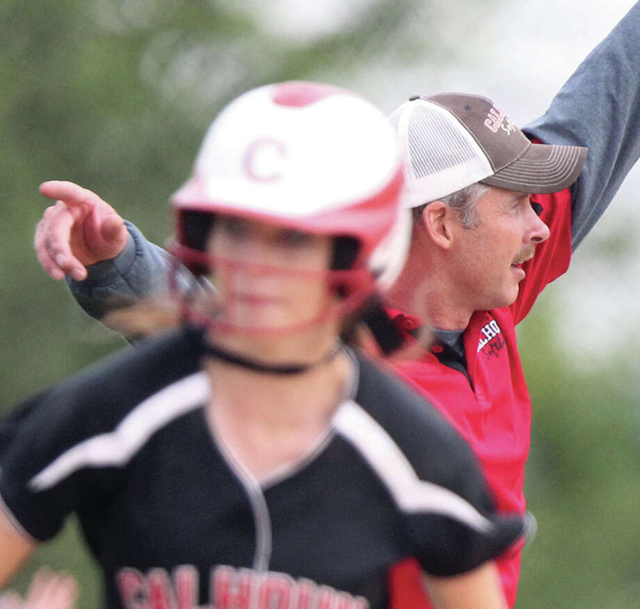 Calhoun coach Matt Baalman (right), shown sending one Warrior home while holding another at second base, is the 2016 Telegraph Small-Schools Softball Coach of the Year after leading Calhoun to a second straight Class 1A state championship. Photo: Dennis Mathes / Journal-Courier