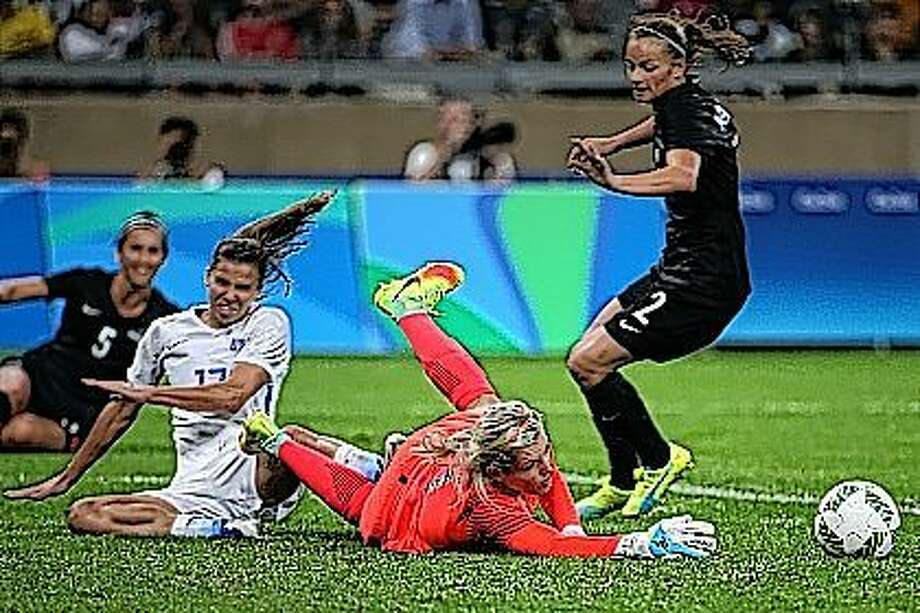 New Zealand goalkeeper Erin Nayler, center, makes a save against United States' Tobin Heath during a women's Olympic football tournament match at the Mineirao stadium in Belo Horizonte, Brazil, on Wednesday. The United States won 2-0. Heath showed no sign of the hamstring injury that had bothered her before the Rio Olympics. Photo: Eugenio Savio | AP