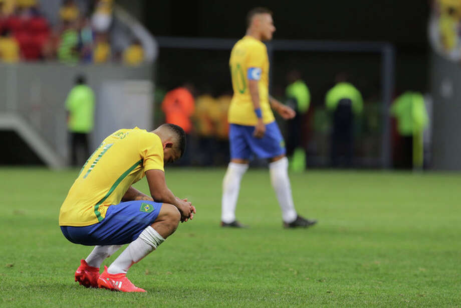 Brazil's Gabriel Jesus, left, reacts at the end a group A match of the men's Olympic football tournament between Brazil and South Africa at the National stadium, in Brasilia, Brazil, Thursday, Aug. 4, 2016. The game ended in a 0-0 draw. (AP Photo/Eraldo Peres)