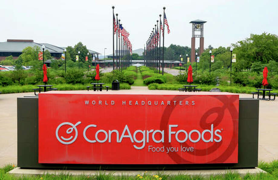 In this Tuesday, June 30, 2015, file photo, flags fly over ConAgra Foods world headquarters in Omaha, Neb. Nearly a decade after hundreds of Americans got sick after eating Peter Pan peanut butter tainted with salmonella, ConAgra Foods appears close to settling a federal criminal case stemming from the outbreak. Federal prosecutors announced last year that Chicago-based ConAgra had agreed to pay $11.2 million, a sum that includes the highest fine ever in a U.S. food safety case,and plead guilty to a single misdemeanor charge in the 2007 outbreak.
