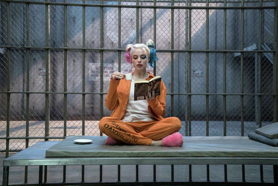"This image released by Warner Bros. Pictures shows Margot Robbie in a scene from ""Suicide Squad."""
