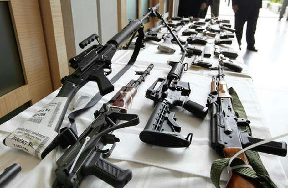 In this July 22, 2010, file photo, various guns are displayed at the Chicago FBI office. A new poll shows most young adults across racial and ethnic groups support tighter gun polices including background checks, stricter penalties for gun law violations, and banning semi-automatic weapons. In the new GenForward poll, about 9 in 10 young adults say they support criminal background checks for all gun sales, a level of support that remains consistent across racial and ethnic groups.