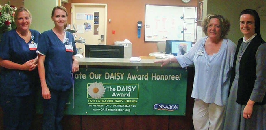 As a partner in the international DAISY Award program that recognizes the extraordinary clinical skill and compassionate care of nurses, OSF Saint Anthony's Health Center recently awarded its quarterly DAISY Award to registered nurse Jill Harper. Photo: For The Telegraph