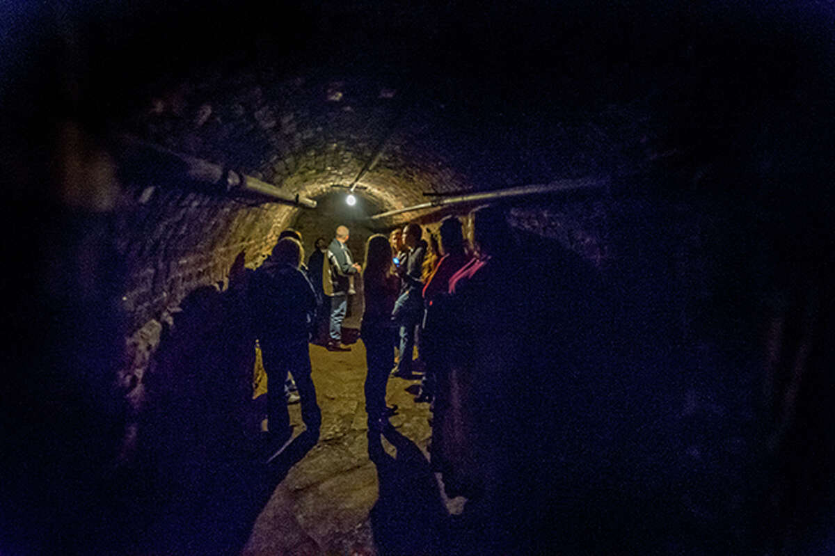 A group takes a tour with Alton Hauntings.