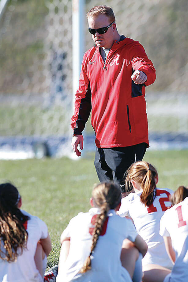 Alton High girls soccer coach Jeff Hayes gives instructions to his team during a Home SWC game against Collinsville. Photo: Scott Kane File Photo | For The Telegraph