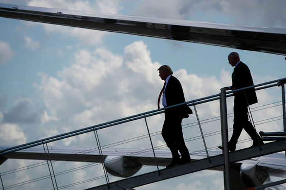 Republican presidential candidate Donald Trump steps off his plane after arriving for a campaign rally at Crown Arena, Tuesday, Aug. 9, 2016, in Fayetteville, N.C.