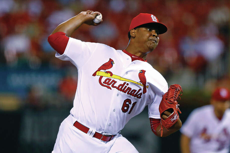 Cardinals reliever Alex Reyes, making his major league debut, pitches during the ninth inning of a baseball game against the Reds on Tuesday night at Busch Stadium. Reyes retired all three batters he faced in the Cards' 7-4 loss. Photo: Billy Hurst / Associated Press