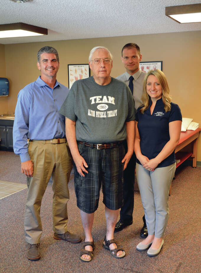 Jerry Magurany, center, surrounded by the health team who helped him to improve his mobility and quality of life, from left, Steve Schwegel, physical therapist and owner of Alton Physical Therapy, Dr. John W. Stirton, orthopaedic surgeon with BJC Medical Group of Illinois, and Dr. Katie Drake Sherer, a chiropractor and nutritionist and co-owner of Sherer Chiropractic Center in Jerseyville.
