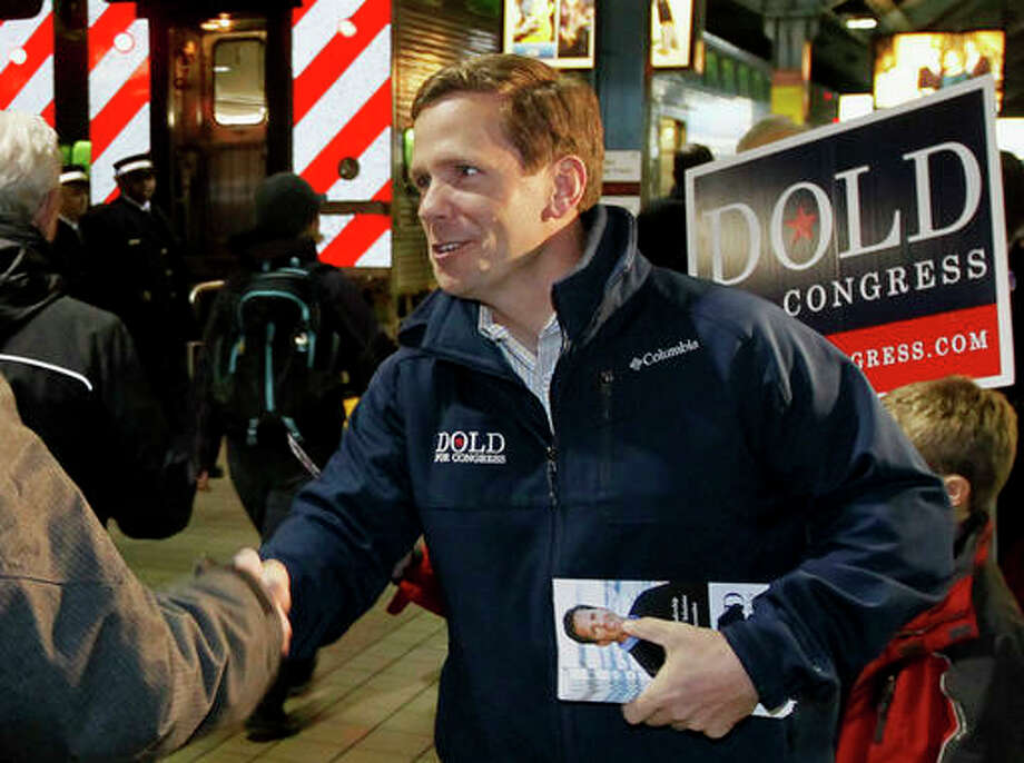 In this Nov. 5, 2012 file photo, U.S. Rep. Bob Dold R-Ill., campaigns in Chicago. Dold and Sen. Mark Kirk R-Ill., both spoke at an event Wednesday, Aug. 10, 2016 in Chicago, arguing for comprehensive immigration reform would help the economy. The two Republicans are considered among the nation's most vulnerable congressional incumbents and are breaking from their party and Donald Trump to advocate for new laws that would include a path to citizenship for people living in the country illegally.