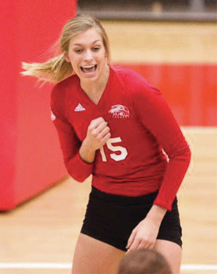 SIUE graduate Kristen Torre, a 6-foot-2 middle blocker from Highland, celebrates a point during a Cougars victory last season at Vadalabene Center in Edwardsville. Photo: SIUE Athletics