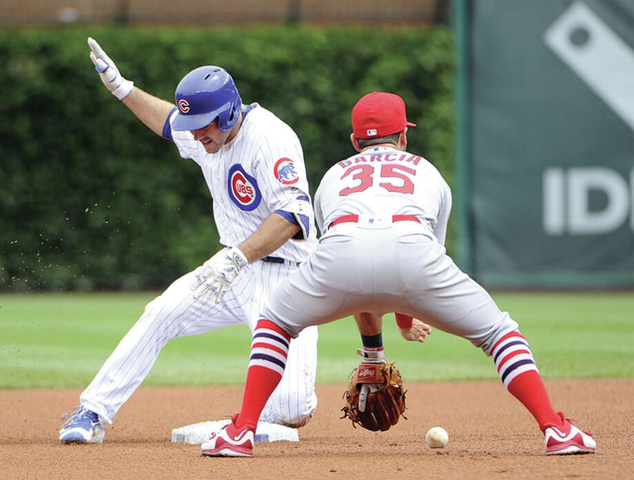 Chicago Cubs' Matt Szczur is safe at second base with a double as Cardinals shortstop Greg Garcia (35) fields a throw during the first inning Friday at Wrigley Field in Chicago. Photo: Associated Press