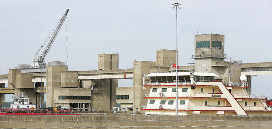 The U.S. Army Corps of Engineers MV Mississippi, right, dwarfs a regular towboat, left, as it locks through the Melvin Price Locks and Dam 26 Friday in Alton. The Mississippi, the largest diesel towboat on the river, was the location Friday for a public meeting by the Mississippi River Commission.