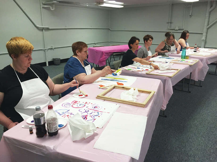 To create a spirit painting, participants pick out colors of paint and use brushes and sticks to paint shapes that come to their minds. Then, they wet a canvas, fold it in half and smear the paint with a stick on either side of the fold and then re-fold the canvas. When the canvas is unfolded, an angelic shape emerges.