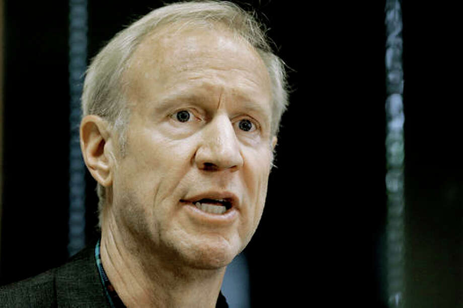 In this July 18 file photo, Illinois Gov. Bruce Rauner speaks to reporters in Taylorville, Ill. The stopgap spending plan that Illinois lawmakers approved this summer in the midst of a long-lasting budget crisis is quickly draining the state's rainy day fund. As of Friday, Aug. 12, 2016, it had about $180 million. In a matter of weeks, the balance will be zero.