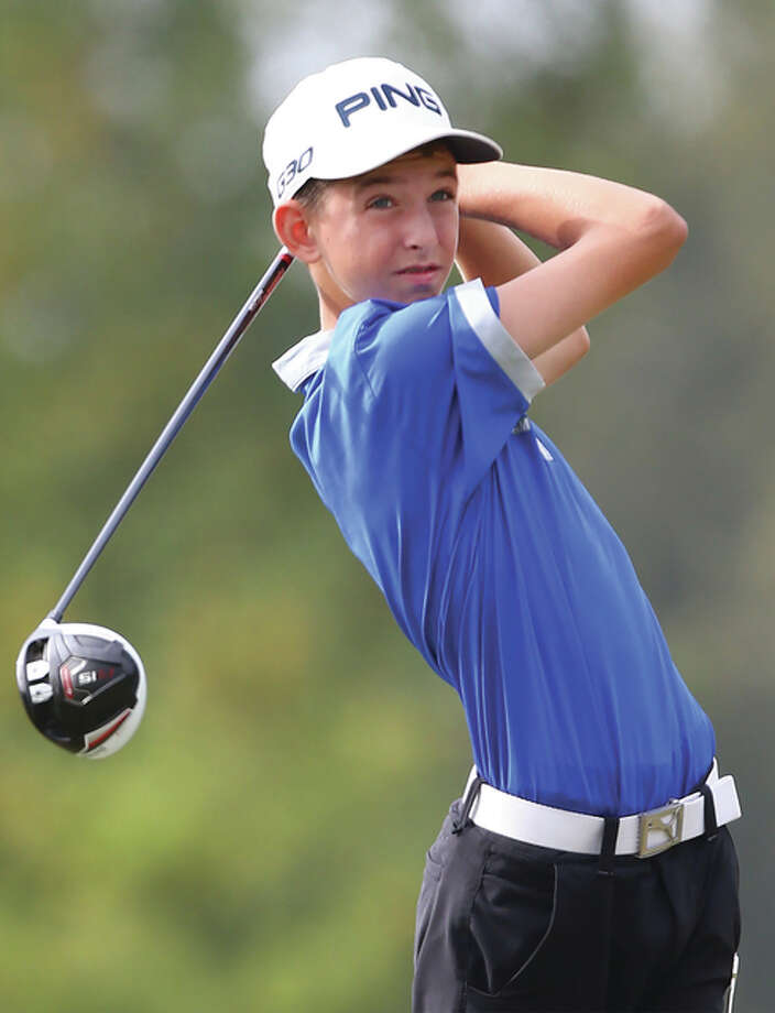 Marquette Catholic's Kolten Bauer tees off in the Class 2A regional at Rolling Hills in Godfrey last season as a freshman. Bauer is part of a returning Explorers' lineup that hopes to contend for a state trophy. Photo: Billy Hurst / For The Telegraph