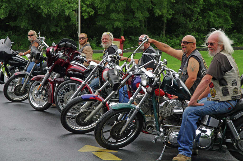 Members of the Alton motorcycle club Back Door Men arrive at Sunday's Heroin Awareness Benefit in Alton, held at the Moose Lodge.