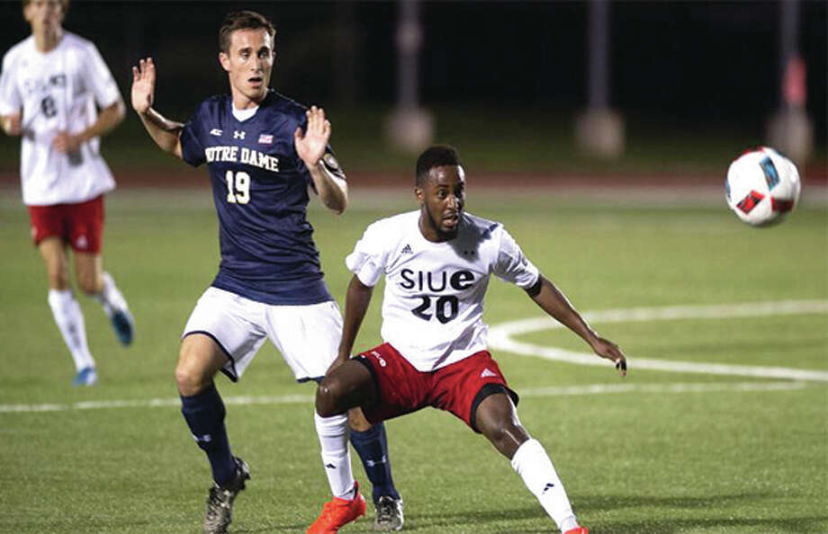 SIUE's Mohamed Awad (20) gets position against Notre Dame's Patrick Connolly during a men's college exhibition match Sunday night at Korte Stadium in Edwardsville. Photo: SIUE Athletics