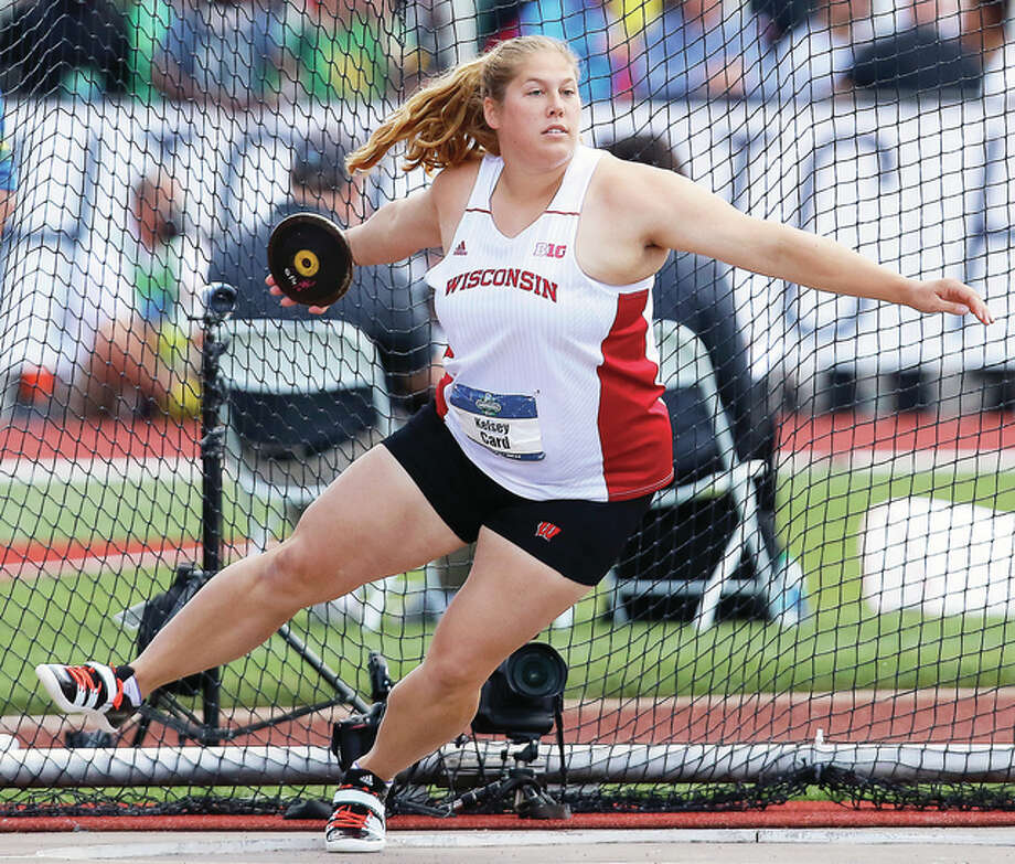 Carlinville's Kelsey Card, shown competing for Wisconsin in the women's discus at the NCAA outdoor track and field championships in Eugene, Ore., on June 11 had her Olympic moment Monday night at the 2016 Summer Olympics in Rio de Janeiro, Brazil. Card, who won the NCAA championship with a personal-best throw of 63.52 meters (208 feet. 5 inches), got off a best effort of 56.41 in the rain-delayed Olympic preliminary round and was unable to advance to Tuesday night's finals. After scratching on her first attempt, Card went 51.16 meters before going 56.41 on her final throw. It was a tough night for the Americans in the discus. Shelbi Vaughan's best throw was 53.33 and Whitney Ashley, who finished first at the U.S. Olympic Trials, fouled on all three of her attempts in the prelims. The top 12 finishers – plus any with a throw of 62 meters or better – from the 34 athletes competing in Monday advance to Tuesday night's finals in Rio. Card finished 25th. Photo: Associated Press