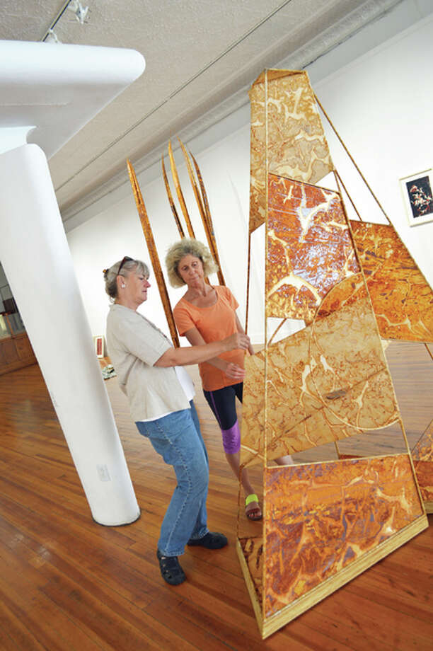 Artist Danne Rhaesa discusses one of her large-scale pieces with Jacoby Arts Center's programs coordinator Penny Schmidt in the Jacoby Arts Center gallery, site of the current exhibit, Natural Force. Photo: Photos By Vicki Bennington|For The Telegraph