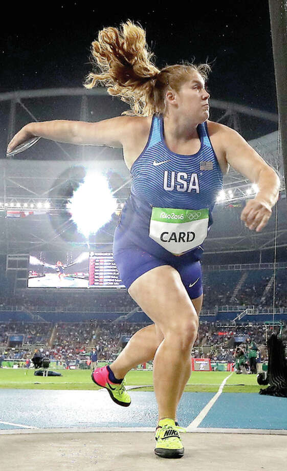 U.S. Olympic discus thrower Kelsey Card, a graduate of Carlinville High and the University of Wisconsin, makes an attempt in the women's discus prelims Monday night at the Olympic stadium in Rio de Janeiro. Photo: Matt Dunham | AP Photo