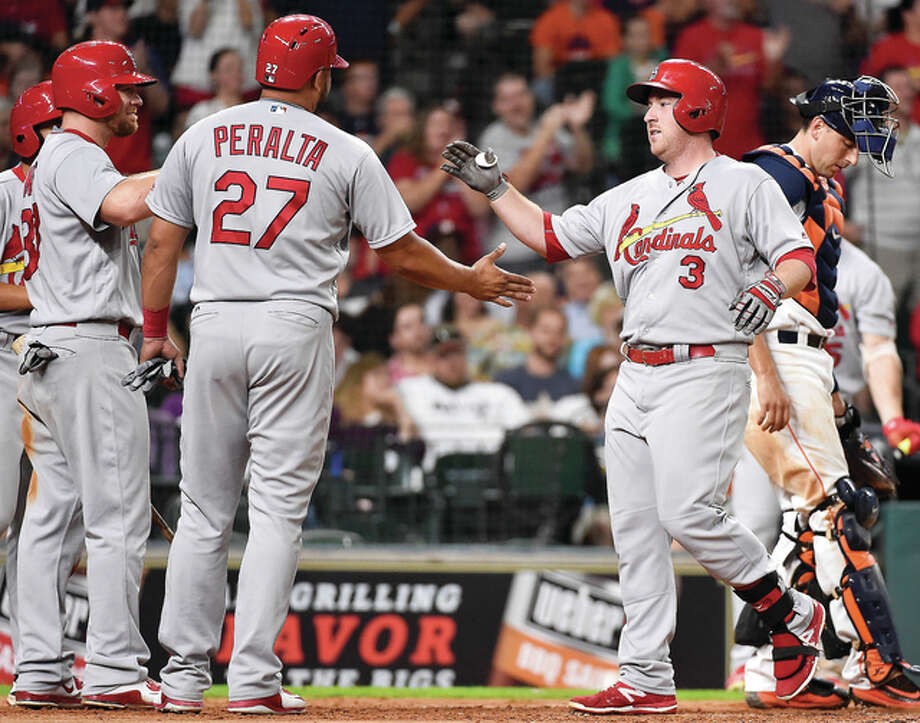 St. Louis Cardinals' Jedd Gyorko (3) celebrates his three-run home run off Houston Astros relief pitcher Pat Neshek with Jhonny Peralta (27) and Brandon Moss, left, during the sixth inning of a baseball game, Tuesday, Aug. 16, 2016, in Houston. (AP Photo/Eric Christian Smith) Photo: Associated Press
