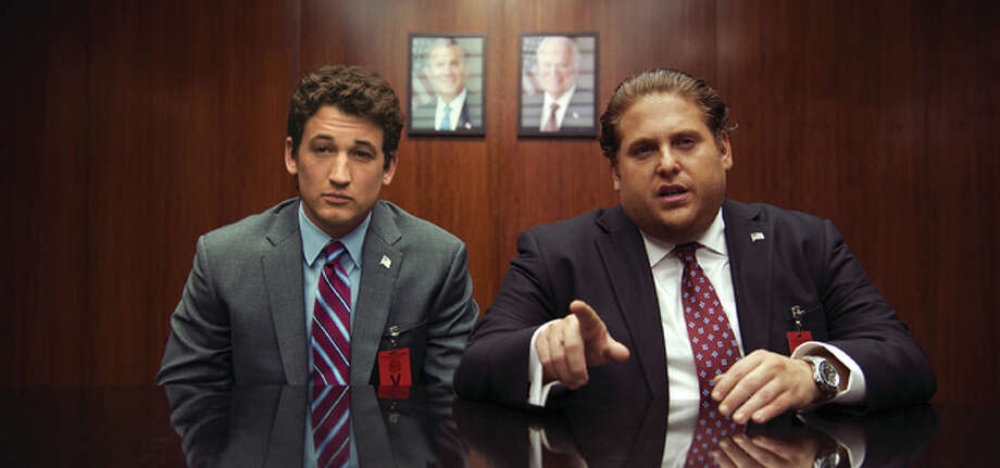 "This image released by Warner Bros. Pictures shows Miles Teller, left, and Jonah Hill in a scene from, ""War Dogs."" Photo: (Warner Bros. Pictures Via AP)"