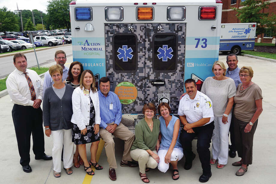 Alton Memorial Hospital leadership and Duck Pluckers Committee members with the new ambulance.