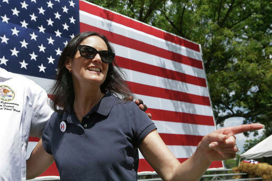 Illinois Attorney General Lisa Madigan greets supporters while participating in a political rally during Democrats Day at the Illinois State Fair Thursday in Springfield, Ill.