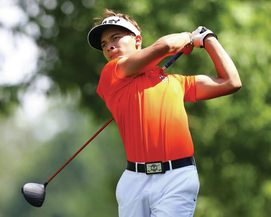 Edwardsville junior Ben Tyrrell watches his tee shot Thursday during the Madison County boys golf tournament at Belk Park in Wood River. Tyrrell, who shot 66 to win the Alton Invite on Tuesday at Olin, came back with a 67 to win the county tourney at Belk. Photo: Billy Hurst / For The Telegraph