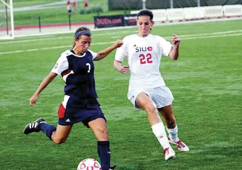 SIUE's Caroline Hoefert, right, a junior from Marquette Catholic, scored twice Friday night in the Cougars' 6-0 win over Chicago State in the season opener at Korte Stadium. She is shown in action from last season. Photo: SIUE Photo