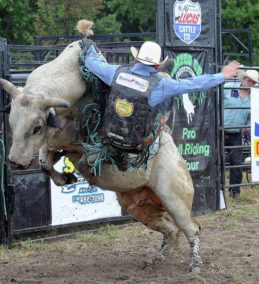 Bull riding action during during the Beverly Farms Amped Up Productions Bull Riding event on Saturday in Godfrey.