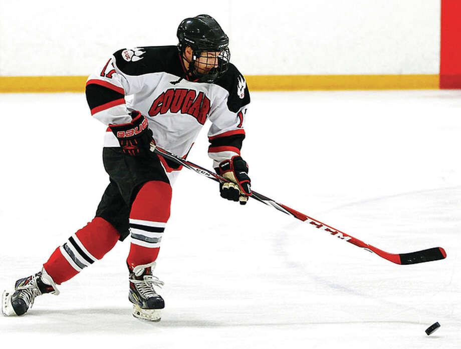 Former Alton Redbird Nick Edwards of SIUE skates with the puck during an off-season workout at the East Alton Ice Arena. Edwards is the Cougars captain and returns as their leading scorer from last season. The team will hold open tryouts at the East Alton rink next weekend.