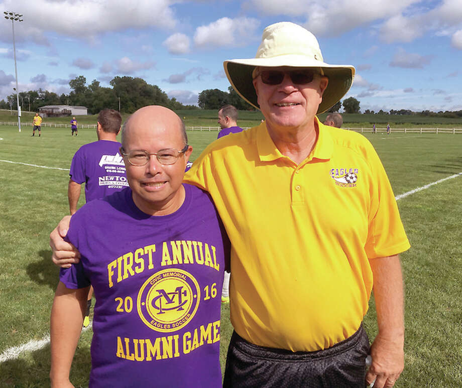 Terry Edwards, left, who played on the first Civic Memorial boys soccer team in 1977, greets former longtime CM coach Don Woelfel at Saturday's first CM Alumni Soccer Game at the Bethalto Sports Complex. Some 60 former Eagles took part. CM's 2016 team, which was to start its season Monday against Roxana, is looking to draw on lessons from last season, as well as on the program's long tradition. Photo: Submitted Photo