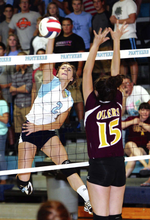 Jersey's Mackenzie Thurston (left) hits past the block of EA-WR's Lexie Johnson during a match last season in Jerseyville. The Panthers and Oilers met again Tuesday night in pool play at the Roxana Tournament. Photo: James B. Ritter/ For The Telegraph