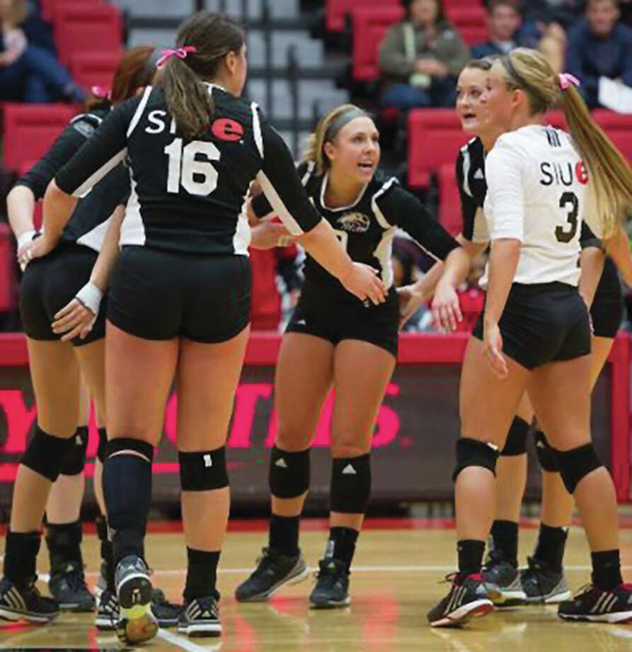 Mallory Mangun (center), a senior setter from Joliet, leads the Cougars into the 2016 season that begins with a Friday night game against the host Raiders in the Wright State Tournament in Dayton, Ohio. The Cougars return all but one starter from last season's 8-18 squad. Photo: SIUE Athletics