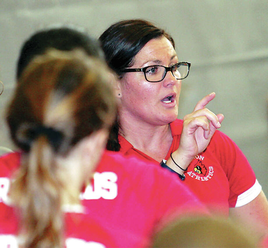 Alton volleyball coach Stacey Ferguson gives her team instructions during action last season. The Redbirds opened at home Wednesday by beating Metro East Lutheran to even their record at 1-1. Photo: James B. Ritter | For The Telegraph