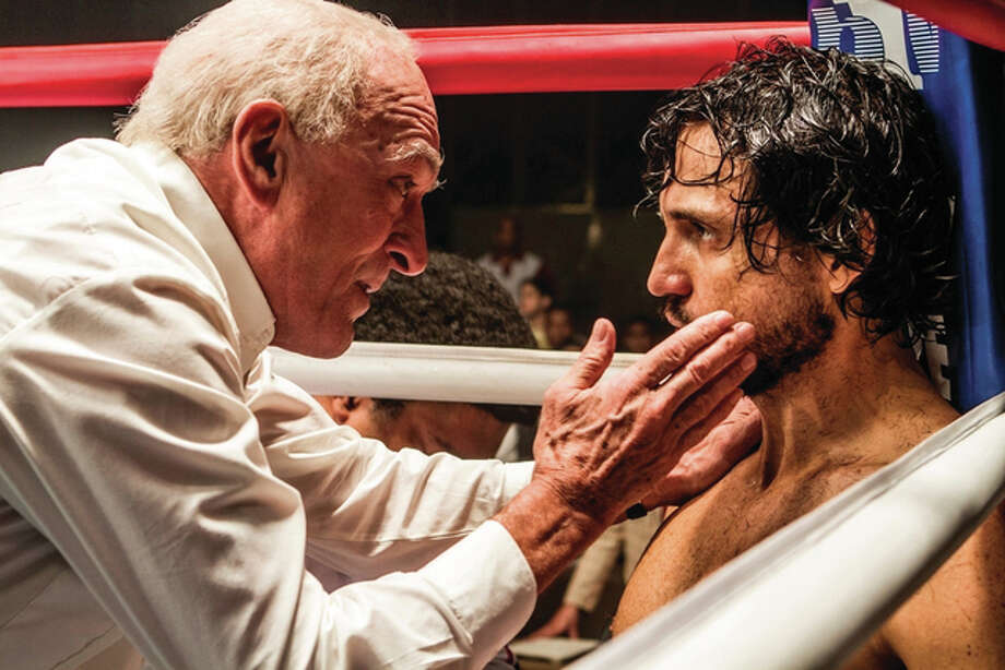 "This image released by The Weinstein Company shows Robert De Niro, left, and Edgar Ramirez in a scene from, ""Hands of Stone."" Photo: (Rico Torres/The Weinstein Company Via AP)"
