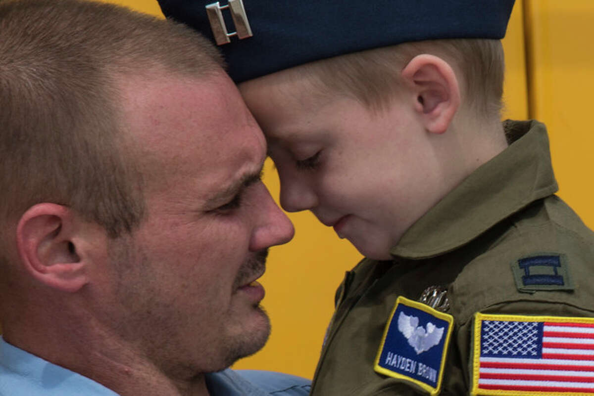 Jonathan Brown and his 6-year-old son, Hayden Brown, share a moment, Aug. 17 at Scott Air Force Base, which teamed up with Alton VFW 1308 and hosted Hayden as an honorary pilot for the day. Brown has a rare degenerative disease called Metachromatic Leukodystrophy, commonly referred to as MLD, and throughout this illness, he has shown tremendous courage and determination.