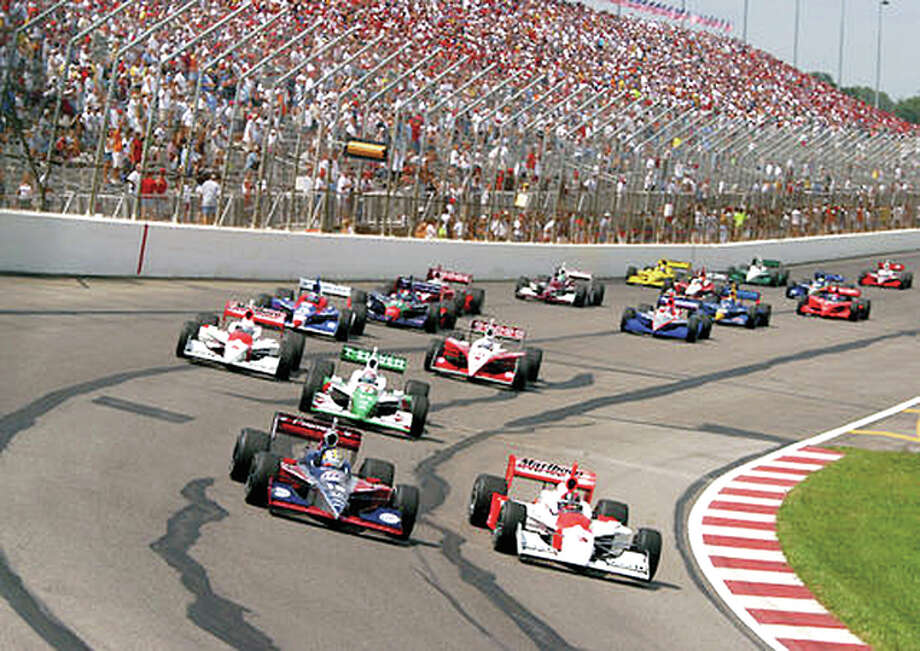 Indy Racing League drivers head around a turn during the Emerson Gateway 250 in 2003 at the former Gateway International Speedway in Madison. Indy-style cars will return next August to the track, now known as Gateway Motorsports Park. Photo: Car.com