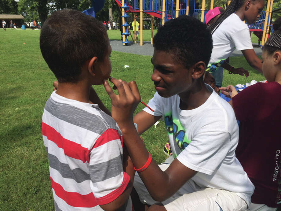 Crowds packed Salu Park Saturday in his memory, having fun and enjoying the day, with face painting, games, basketball, barbecue, music and a balloon-release — all brought together by volunteers and people who knew Wigfall personally. That made up numerous individuals.