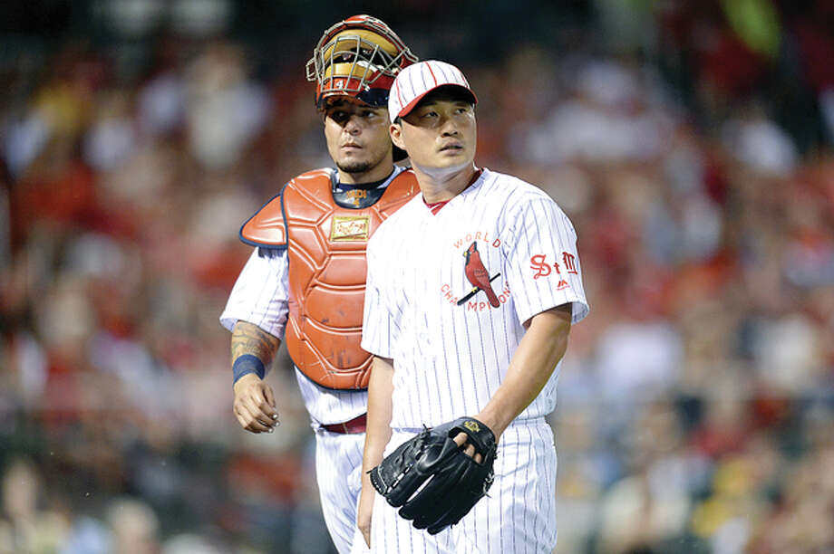 Cardinals relief pitcher Seung Hwan Oh and catcher Yadier Molina look on after the Oakland A's scored two runs in the eighth inning Saturday at Busch Stadium. Photo: AP