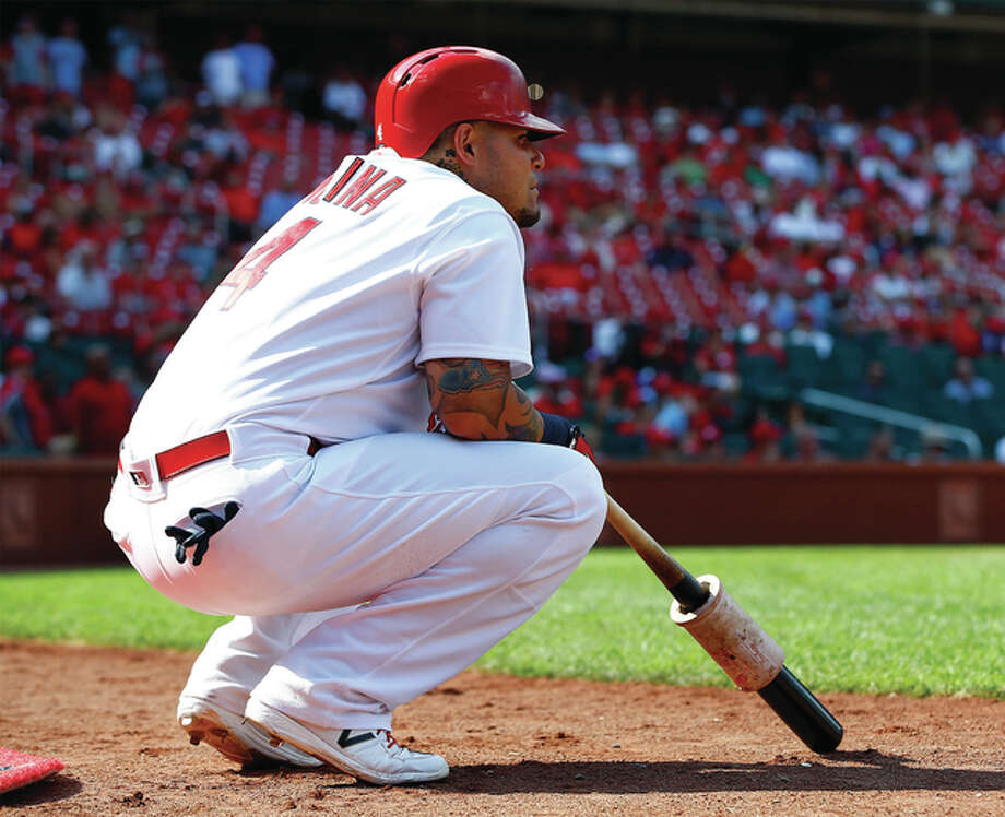 Cardinals catcher Yadier Molina watches from the on-deck circle during Sunday's game against the Oakland Athletics on Sunday at Busch Stadium. Photo: Billy Hurst / Associated Press