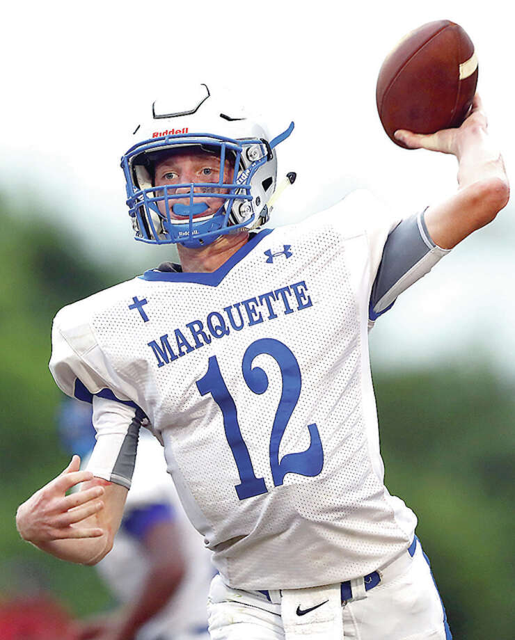 Marquette quarterback Brady Mcafee throws a pass during Friday night's season opener in Bethalto. Photo: Billy Hurst | For The Telegraph