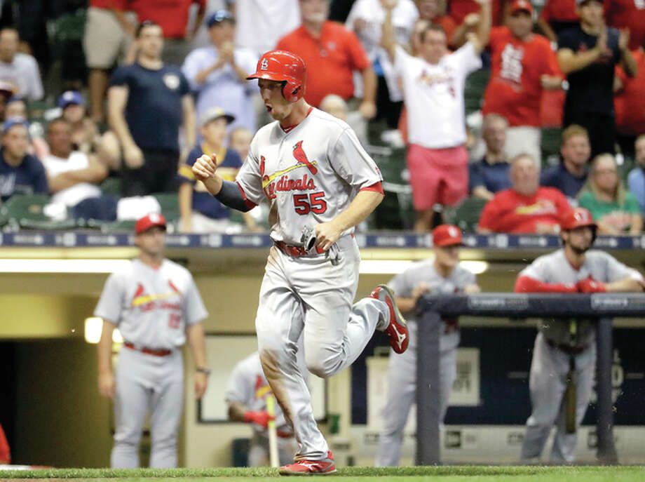 St. Louis Cardinals' Stephen Piscotty reacts as he scores from second on a wild throw on a bunt by Yadier Molina during the ninth inning of a baseball game against the Milwaukee Brewers Monday, Aug. 29, 2016, in Milwaukee. (AP Photo/Morry Gash) Photo: Morry Gash | AP Photo