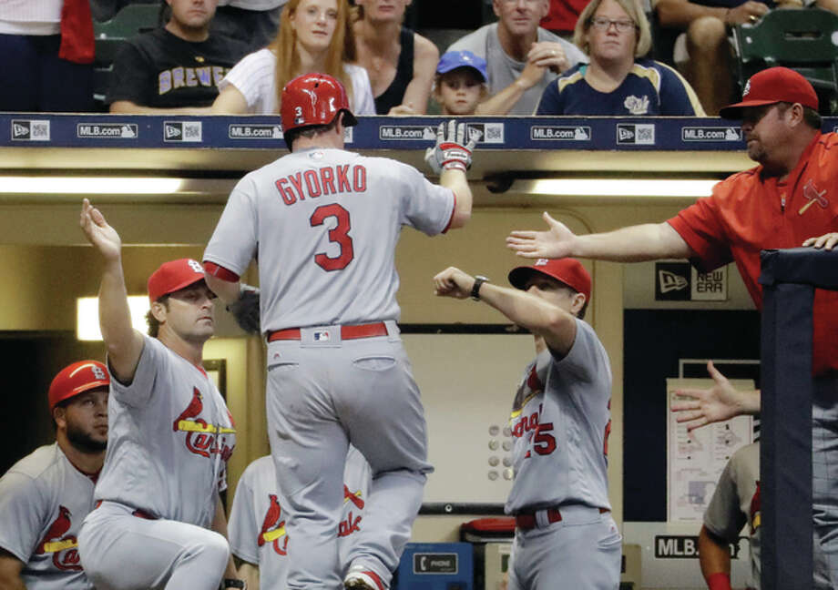 The Cardinals' Jedd Gyorko (3) is congratulated after hitting a home run during the sixth inning Tuesday night against the Brewers in Milwaukee. Photo: Associated Press