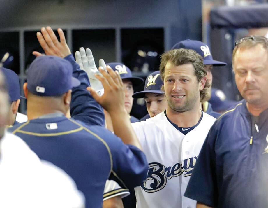 Milwaukee Brewers' Kirk Nieuwenhuis is congratulated in the dugout after hitting a three-run home run during the third inning of a baseball game against the St. Louis Cardinals Wednesday, Aug. 31, 2016, in Milwaukee. (AP Photo/Morry Gash) Photo: AP