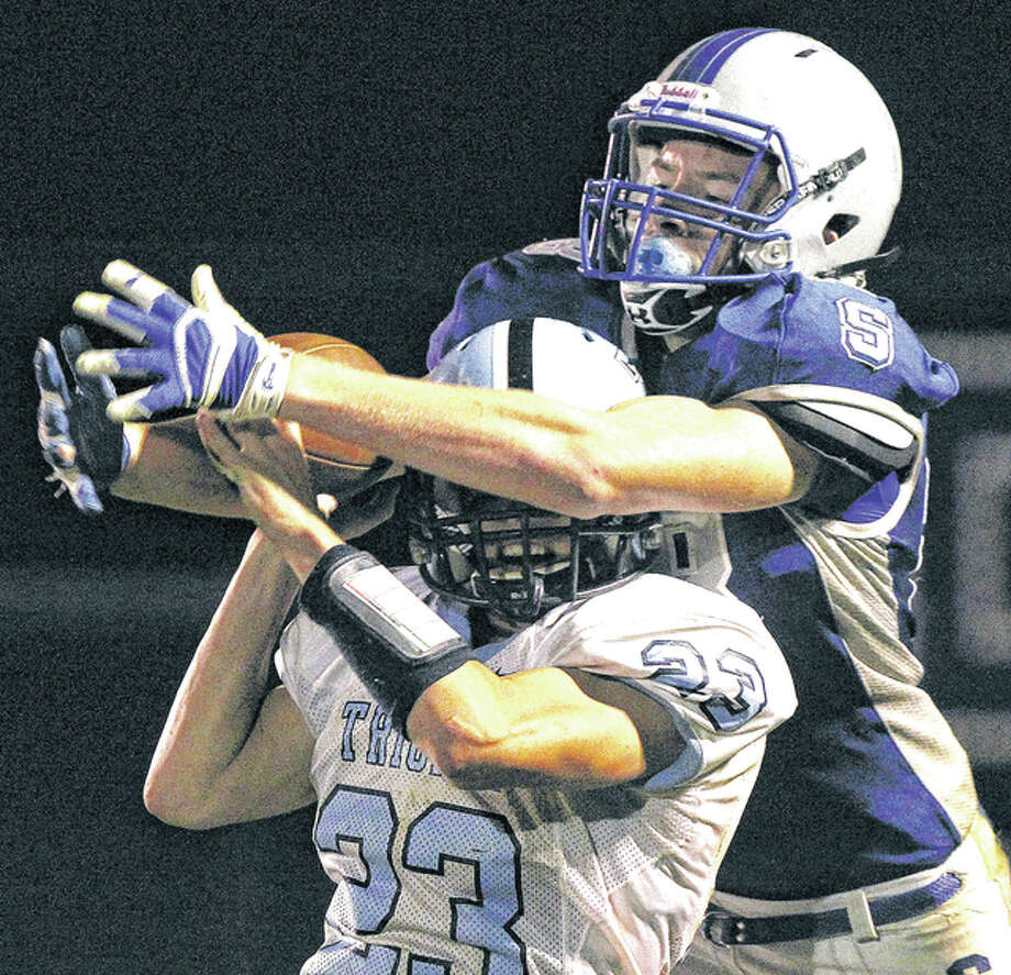 Triopia's Blake Lawson (23) breaks up a pass to North Greene's Josh Hopper on the last play of Friday night's game in White Hall. Photo: Dennis Mathes, Journal-Courier | For The Telegraph