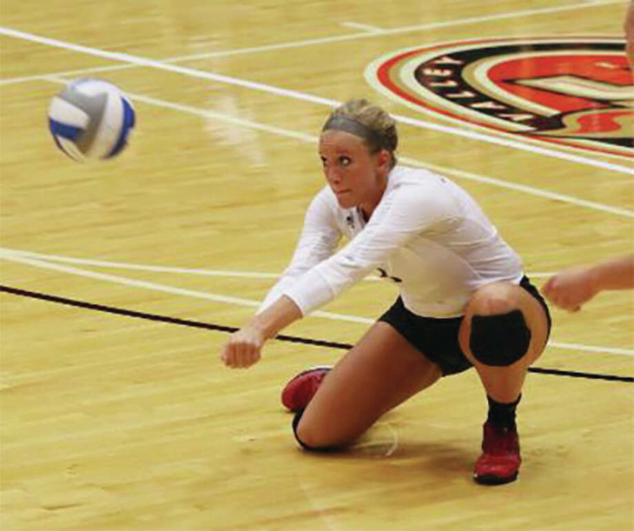 SIUE's Katie Shashack makes one of her career-high 29 digs Friday night during the Cougars' five-set loss to Green Bay in the opening match of the SIUE Tournament at Vadalabene Center in Edwardsville. Photo: SIUE Athletics