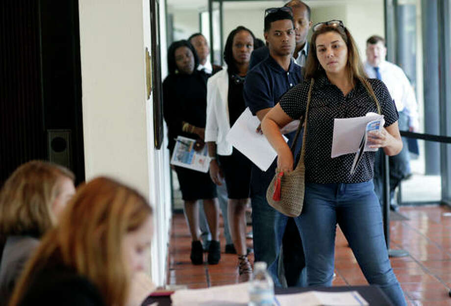 In this Tuesday, July 19, 2016, photo, Raisa Rickie waits in line to apply for a job with Aldi at a job fair in Miami Lakes, Fla. On Friday, Sept. 2, 2016, the U.S. government issues the August jobs report. (AP Photo/Lynne Sladky) Photo: (AP Photo/Lynne Sladky)