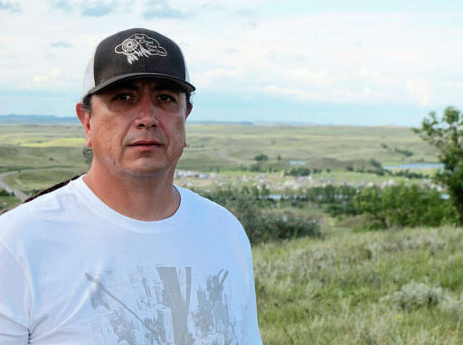 In this Aug. 26 photo, Standing Rock Sioux Chairman Dave Archambault II poses for a photo near Cannon Ball., N.D., on the Standing Rock Sioux Reservation overlooking an encampment where Native Americans from across North America have gathered to join his tribe's growing protest against a $3.8 billion four-state oil pipeline. About 30 people, including Archambault himself, have been arrested in recent weeks for interfering with construction of the Dakota Access pipeline.
